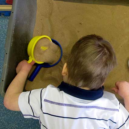 child with sand