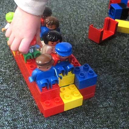 child with Duplo